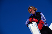 Portait of young male snowboarder.