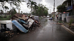 Debris left over from Hurricane Maria as well as furniture, appliances and washed out vehicles, litter a street in Toa Baja Puerto Rico, on October 12, 2017. Photo by Jose A. Iglesias/El Nuevo Herald/TNS/ABACAPRESS.COM