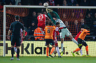 Brentford goalkeeper Luke Daniels (28) makes a diving save  during The FA Cup fourth round match between Barnet and Brentford at The Hive Stadium, London, England on 28 January 2019.