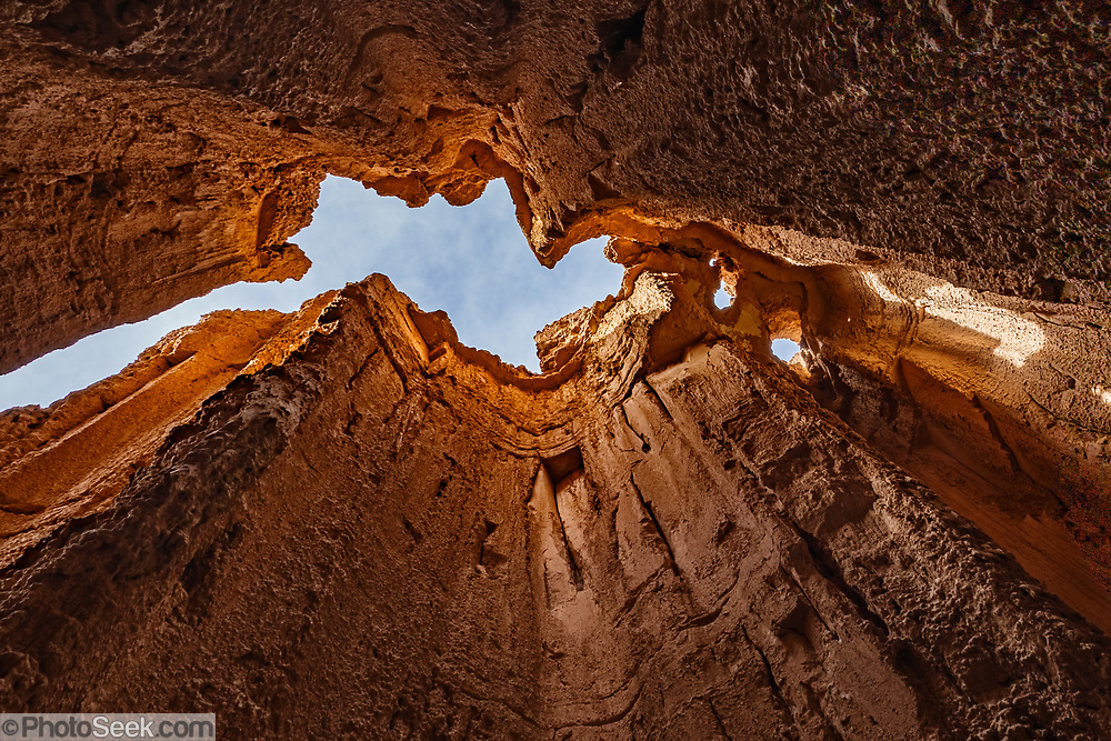 Inside a slot canyon at the Moon Caves in Cathedral Gorge State Park, Panaca, Nevada, USA. Million-year-old lake sediments have eroded into fantastic mud castles at Cathedral Gorge State Park. This image was HDR-stitched from two photos to increase the dynamic range from light to dark with low noise.