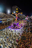 Float with a crucifix in the Carnaval parade of GRES Estacao Primeira de Mangueira samba school in the Sambadrome, Rio de Janeiro, Brazil.