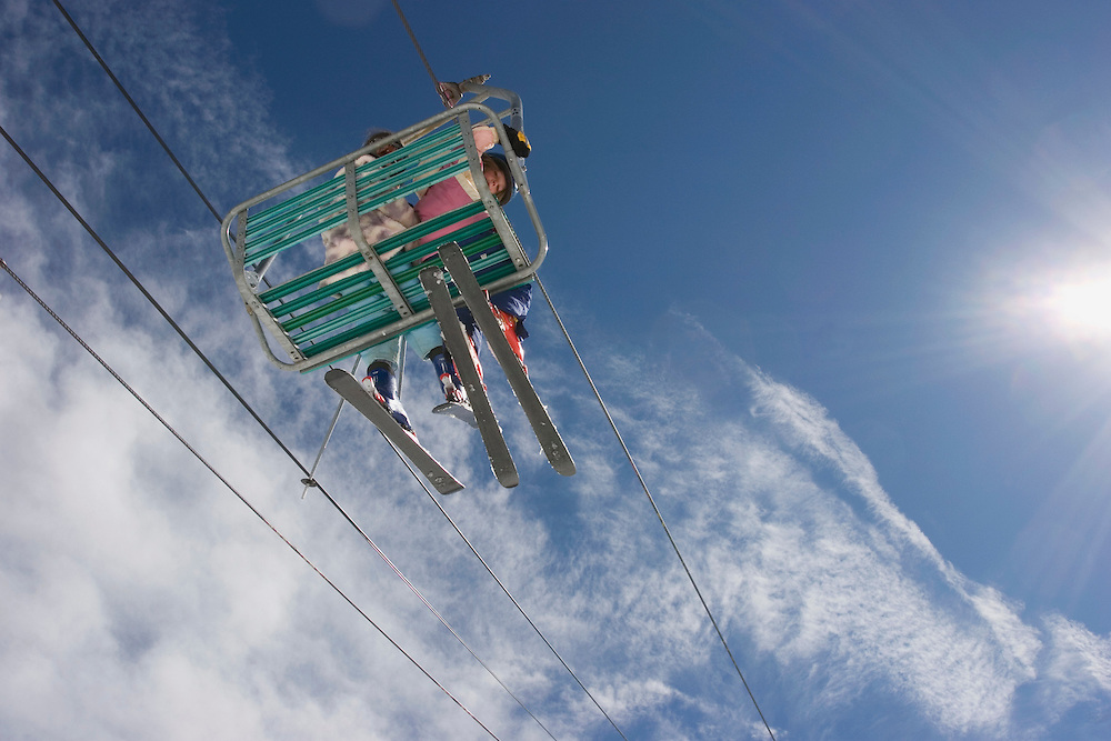 Skiers on chairlift, Taos Ski Valley, New Mexico
