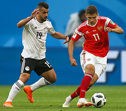 June 19, 2018 - Saint Petersburg, Russia - Abdalla Said (L) of the Egypt national football team and Roman Zobnin of the Russia national football team vie for the ball during the 2018 FIFA World Cup match, first stage - Group A between Russia and Egypt at Saint Petersburg Stadium on June 19, 2018 in St. Petersburg, Russia. (Credit Image: © Igor Russak/NurPhoto via ZUMA Press)