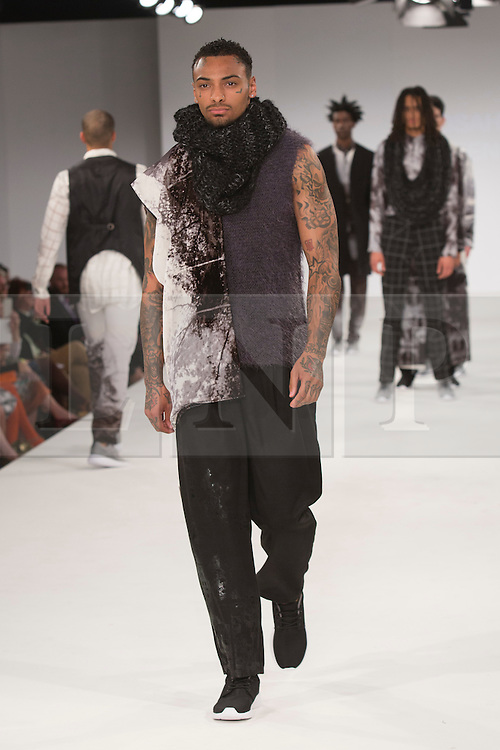 © Licensed to London News Pictures. 30/05/2015. London, UK. A model walks the runway during the UCA Rochester fashion show at Graduate Fashion Week 2015 wearing the collection of graduate student Arosa Yaseen. Graduate Fashion Week takes place from 30 May to 2 June 2015 at the Old Truman Brewery, Brick Lane. Photo credit : Bettina Strenske/LNP