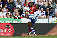 Elias Kachunga of Huddersfield Town and Jordan Obita of Reading compete for the ball. EFL Skybet  championship match, Reading  v Huddersfield Town at The Madejski Stadium in Reading, Berkshire on Saturday 24th September 2016.<br /> pic by John Patrick Fletcher, Andrew Orchard sports photography.