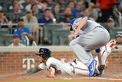 May 15, 2018 - Atlanta, GA, U.S. - ATLANTA, GA Ð MAY 15:  Braves infielder Johan Camargo (17) tries to score on a wild pitch but is tagged out by the Cubs pitcher Mike Montgomery (38) during the game between Atlanta and Chicago on May 15th, 2018 at SunTrust Park in Atlanta, GA. The Chicago Cubs defeated the Atlanta Braves by a score of 3 -2.  (Photo by Rich von Biberstein/Icon Sportswire) (Credit Image: © Rich Von Biberstein/Icon SMI via ZUMA Press)