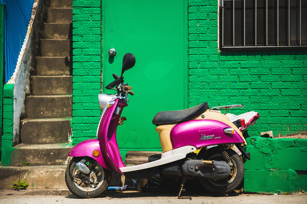 Scooter parked in an alley.  Anjeong-ri, South Korea