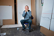 UK. London. Tibetan artist Gonkar Gyatso in his studio in Bethnal Green, East London.