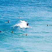 A group of surfers waits for waves at Point Lookout on Stradbroke Island, Queensland's most easterly point. North Stradbroke Island, just off Queensland's capital city of Brisbane, is the world's second largest sand island and, with its miles of sandy beaches, a popular summer holiday destination.