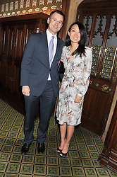Secretary of State for Health JEREMY HUNT MP and his wife LUCIA HUNT at a gala dinner in aid of Nyumbani the Hot Courses Foundation held in The Members Dining Room,  The House of Commons, London on  7th March 2013.