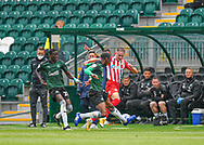 Plymouth Argyle midfielder Tyrese Fornah (18) makes a sliding tackle in  front of the dugout  during the EFL Sky Bet League 1 match between Plymouth Argyle and Sunderland at Home Park, Plymouth, England on 1 May 2021.