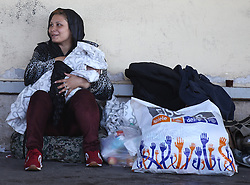 © London News Pictures. 06/09/2015. A migrant woman is seen at Wien Westbahnhof train station, Vienna, Austria, September 6 2015.  Hundreds of migrants have resumed their journey through Austria to Germany after Hungary's decision on Friday to let them through. Picture by Paul Hackett/LNP