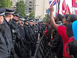 © licensed to London News Pictures. London, UK. 6/06/12. Protestors chant and throw missiles as the a vehicle believed to contain the Sri Lankan president leaves the hotel. Demonstration takes place outside the Hilton Hotel, Park lane, over the attendance of the Sri Lankan president Mahinda Rajapaksa, accused of presiding over human rights abuses, at the Commonwealth Lunch with the Queen. Photo credit: Jules Mattsson/LNP