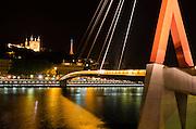 Passerelle du Palais de Justice footbridge and Fourvière Basilica at night, Lyon, France (UNESCO World Heritage Site)