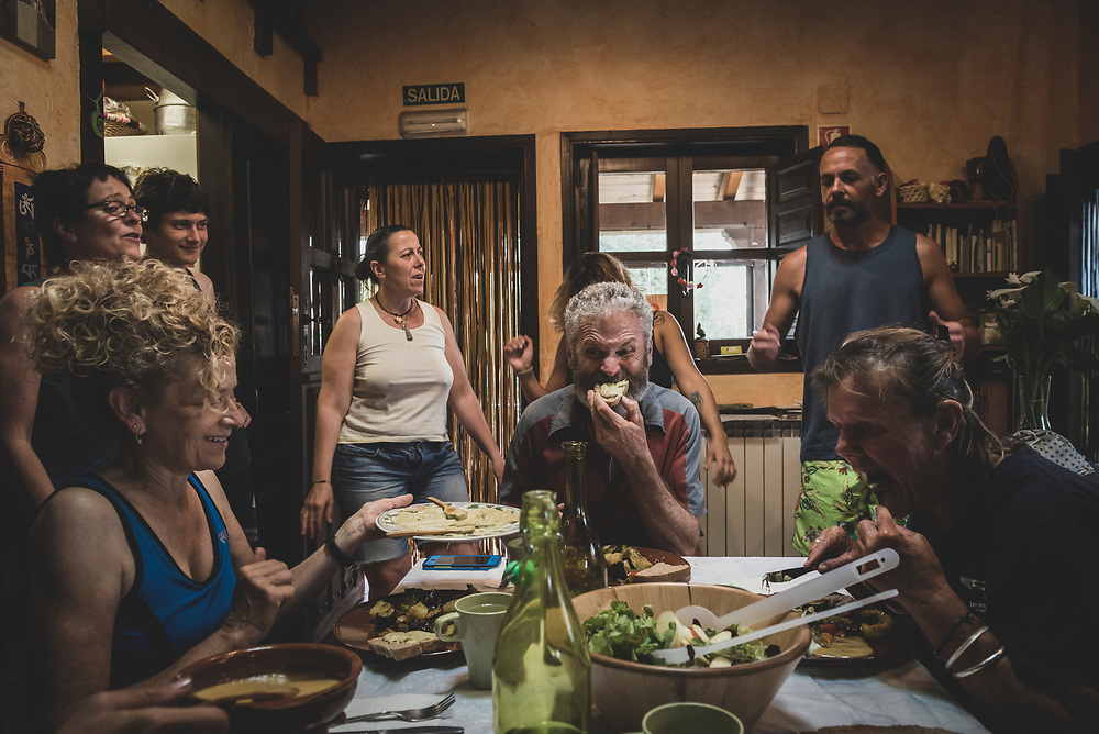 Pilgrims sit for dinner at Albergue Verde as staff and volunteers sing a song. This wonderful albergue, where many a pilgrim end up staying more than one night -- I stayed for three - is in Hospital de Órbigo, Spain. (June 26, 2018)<br /> <br /> DAY 30: VILLAR DE MAZARIFE TO HOSPITAL DE ORBIGO -- 14 KM