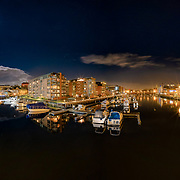 website: www.aziznasutiphotography.com                                           Picture has been taken from Blomsterbrua (Verfstbru). It is a panoramic picture with the full moon and beautiful TRondheim's night