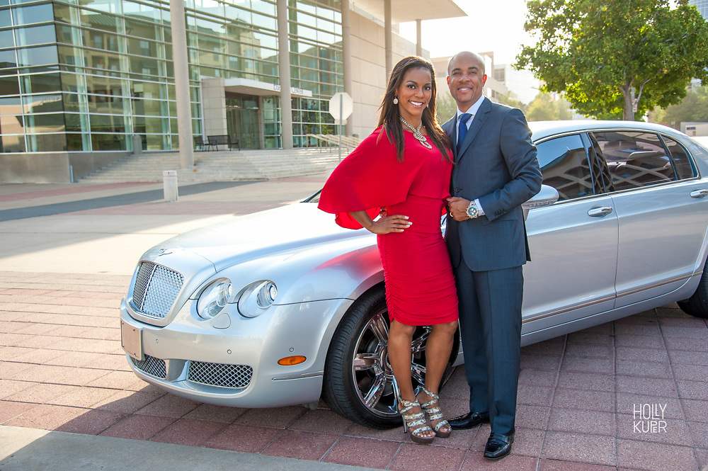 Portrait of couple with their new car