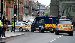 © London News Pictures. 30/05/2013. London, UK.  A police convoy carrying Michael Adebowale leaving Westminster magistrates court in London where Michael Adebowale appeared charged with the murder of soldier Lee Rigby in south-east London last week. A second man accused of murder, Michael Adebolajo, remains under arrest at a London hospital. Photo credit: Ben Cawthra/LNP