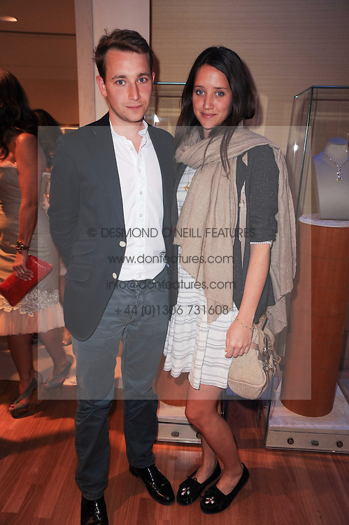 INDIA LANGTON and OLLIE RAMPLEY at a party to celebrate the B.zero 1 design by Anish Kapoor held at Bulgari, 168 New Bond Street, London n 2nd June 2010.