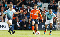 Luton Town's Lawson D'Ath is pressured by Blackpool's Brad Potts (left) and Neil Danns<br /> <br /> Photographer David Shipman/CameraSport<br /> <br /> The EFL Sky Bet League Two - Luton Town v Blackpool - Saturday 1st April 2017 - Kenilworth Road - Luton<br /> <br /> World Copyright © 2017 CameraSport. All rights reserved. 43 Linden Ave. Countesthorpe. Leicester. England. LE8 5PG - Tel: +44 (0) 116 277 4147 - admin@camerasport.com - www.camerasport.com