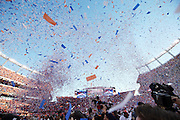 Confetti fills the skies of Sports Authority Field at Mile High in this general view photo of the interior of the stadium after the Denver Broncos win the NFL football AFC Championship Game against the New England Patriots on Sunday, Jan. 19, 2014 in Denver. The Broncos won the game 26-16. ©Paul Anthony Spinelli