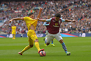 Kieran Richardson of Aston Villa (r) and Emre Can of Liverpool compete for the ball. The FA Cup, semi final match, Aston Villa v Liverpool at Wembley Stadium in London on Sunday 19th April 2015.<br /> pic by John Patrick Fletcher, Andrew Orchard sports photography.