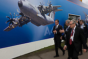 Farnborough, UK 09/07/12 British Prime Minister David Cameron walks past one of the Airbus exhibition stands at the Farnborough Air Show, England. Helping to launch this expo held for the international aviation and aerospace industries, Cameron toured stands to help promote trade and investment for this 48th airshow (FIA)and hailed the phenomenal success of the UK aerospace industry and its critical importance to growth and jobs. Farnborough is attended by an international business audience including 83 trade and military delegations from over 43 countries..