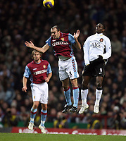 Photo: Rich Eaton.<br /> <br /> Aston Villa v Manchester United. The Barclays Premiership. 23/12/2006. Gavin McCann left of Villa and Louis Saha right of Man United go for a header