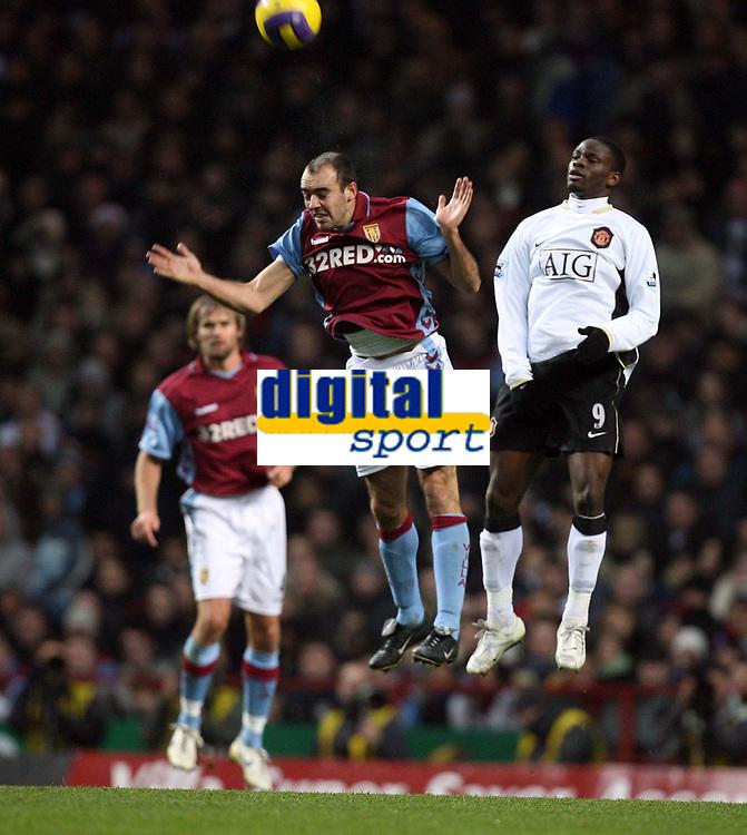 Photo: Rich Eaton.<br /> <br /> Aston Villa v Manchester United. The Barclays Premiership. 23/12/2006. Gavin McCann left of Villa and Louis Saha right of Man United go for a header