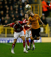 Photo: Steve Bond/Sportsbeat Images.<br /> Wolverhampton Wanderers v Bristol City. Coca Cola Championship. 03/11/2007. Andy Keogh (R) gets to the ball before Bradley Orr (L)