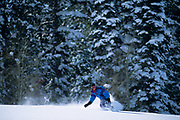 Male snowboarder in action.