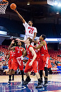 Kelsey Barlow (45) of the UIC Flames rises above opponents of the YSU Penguins, and goes in for the layup on January 7, 2014 in Chicago, Illinois. Barlow led the team with 17 points, making this his 14th double digit game of the season.