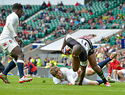 Barbarians wing Ugo Monye (Harlequins & England) evades the tackle of England centre Elliot Daly (Wasps) close to the line during the International Rugby Union match England XV -V- Barbarians at Twickenham Stadium, London, Greater London, England on May  31  2015. (Steve Flynn/Image of Sport)