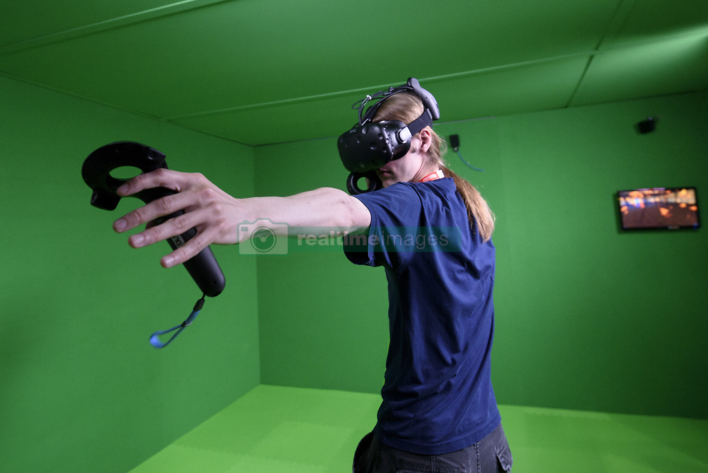 June 13, 2017 - Los Angeles, California, United States - An attendee plays a video game using virtual reality during E3 Electronic Entertainment Expo on June 13, 2017 in Los Angeles, California. E3 is the world's leading computer and video game event that introduces new video games and gaming technologies to more than 60,000 attendees from around the world.(MANDATORY Photo By: Ronen Tivony) (Credit Image: © Ronen Tivony/NurPhoto via ZUMA Press)