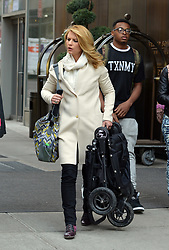 April 25, 2014 - New York, New York, U.S. - Actress CLAIRE DANES wears a white overcoat, jeans and multi colored shoes as she carries a baby stroller outside a Soho hotel. (Credit Image: © Curtis Means/Ace Pictures/ZUMAPRESS.com)
