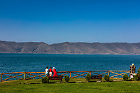Tourists looking at the panorama landscape of Lake Sevan landmark of Gegharkunik Armenia eastern Europe