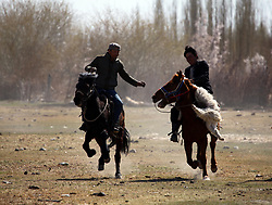 May 25, 2017 - Hami, Hami, China - Hami,CHINA-April 11 2015: (EDITORIAL USE ONLY. CHINA OUT) ..Sheep snatching contest is a traditional sport of Kazakhstan people in northwest China's Xinjiang Uygur Autonomous Region. Participants snatch sheep while riding horse during the contest. (Credit Image: © SIPA Asia via ZUMA Wire)