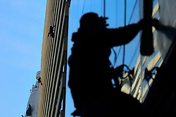 Window washers work on cleaning an office building in Center City Philadelphia, PA, on March 11, 2019. Winter weather made place for more spring like conditions.