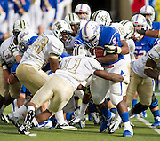 Dec 1, 2012; Tulsa, Ok, USA; Tulsa Hurricanes tailback Alex Singleton (8) is brought down by University of Central Florida Knights linebacker Jonathan Davis (11) and defensive lineman Troy Davis (58) during a game at Skelly Field at H.A. Chapman Stadium. Tulsa defeated UCF 33-27 in overtime to win the CUSA Championship. Mandatory Credit: Beth Hall-USA TODAY Sports