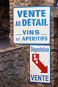 Caves Veuve Banyuls, wine cellar sign in blue. Advertising sale of wine in the wine shop. Collioure. Roussillon. The wine shop and tasting room. France. Europe.