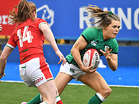 Rugby Union - 2021 Women's Six Nations - Group B - Round Two - Wales vs Ireland - Cardiff Arms Park<br /> <br />  Beibhinn Parsons (Ballinasloe/Blackrock College/Connacht)of Ireland catches a chip ahead to score a try  despite the tackle of Lisa Neumann (Sale Sharks) of Wales<br /> <br /> COLORSPORT/WINSTON BYNORTH