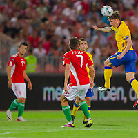 Hungary's Imre Szabics (L) and Adam Pinter (C front) watch as Sweden's Kim Kallstrom (R) makes a header during the UEFA EURO 2012 Group E qualifier Hungary playing against Sweden in Budapest, Hungary on September 02, 2011. ATTILA VOLGYI