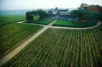 aerial view of the Chateau Yquem and its vineyards, in Sauternes, France, near Bordeaux..Chateau Yquem Sauternes is one of the most prestigious and most expensive wines in the world..2003...© Owen Franken....