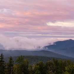 """Clouds hug the ridge of """"The Horn"""" (right) on Saddleback Ridge as seen from Quill Hill in Reddington Township, Maine. High Peaks region near Rangeley. Appalachian Trail."""