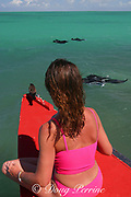visitor and brown noddy share bow of outrigger boat and observe manta rays feeding in lagoon, Christmas Island ( Kiritimati ), Republic of Kiribati, northern Line Islands, equatorial Central Pacific Ocean, MR 299