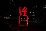 The LOVE statue is lit by red light Sept. 1, 2020, in Philadelphia, Pennsylvania, signifying the 'Red Alert' workers in the live events industry are facing due to the impact of the COVID-19 pandemic. This nationwide effort, organized by the Live Events Coalition, is also a push for Congress towards continuation and extension of the Pandemic Unemployment Assistance to provide relief to those without work due to COVID-19.