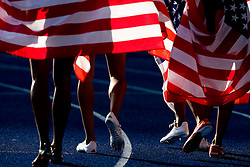 Shoes of Sanya Richards (R) of the United States when she celebrates winning the gold medal in the women's 4x400 Metres Relay Finalduring day nine of the 12th IAAF World Athletics Championships at the Olympic Stadium on August 23, 2009 in Berlin, Germany. (Photo by Vid Ponikvar / Sportida)