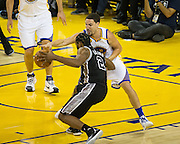 Golden State Warriors guard Klay Thompson (11) reaches for a steal against San Antonio Spurs forward Kawhi Leonard (2) at Oracle Arena in Oakland, Calif., on October 25, 2016. (Stan Olszewski/Special to S.F. Examiner)