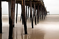 NC01274-00...NORTH CAROLINA - A stormy day at Nags Head Pier with a 10-stop neutral density filter.