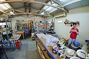 An European female potter in her workshop